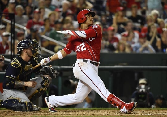 Aug 17, 2019; Washington, DC, USA; Washington Nationals left fielder Juan Soto (22) hits a two run home run against the Milwaukee Brewers during the third inning at Nationals Park. Mandatory Credit: Brad Mills-USA TODAY Sports