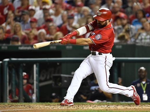 Aug 17, 2019; Washington, DC, USA; Washington Nationals right fielder Adam Eaton (2) hits a three run home run against the Milwaukee Brewers during the fourth inning at Nationals Park. Mandatory Credit: Brad Mills-USA TODAY Sports