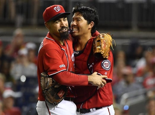 Aug 17, 2019; Washington, DC, USA; Washington Nationals third baseman Anthony Rendon (6) and catcher Kurt Suzuki (28) react after colliding during the fourth inning against the Milwaukee Brewers at Nationals Park. Mandatory Credit: Brad Mills-USA TODAY Sports