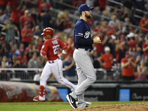 Aug 17, 2019; Washington, DC, USA; Milwaukee Brewers starting pitcher Jordan Lyles (23) reacts after giving up a two run home run to Washington Nationals left fielder Juan Soto (22) during the third inning at Nationals Park. Mandatory Credit: Brad Mills-USA TODAY Sports