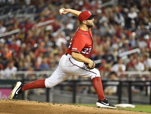 Aug 17, 2019; Washington, DC, USA; Washington Nationals relief pitcher Matt Grace (33) throws against the Milwaukee Brewers during the fifth inning at Nationals Park. Mandatory Credit: Brad Mills-USA TODAY Sports