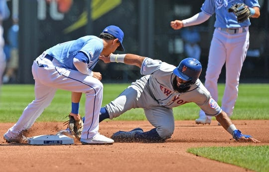 Aug 18, 2019; Kansas City, MO, USA; New York Mets shortstop Amed Rosario (1) gets tagged out by Kansas City Royals shortstop Nicky Lopez (1) attempting to steal second, during the first inning against at Kauffman Stadium. Mandatory Credit: Peter G. Aiken/USA TODAY Sports