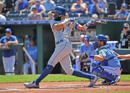 Aug 18, 2019; Kansas City, MO, USA; New York Mets shortstop Amed Rosario (1) singles during the first inning against the Kansas City Royals at Kauffman Stadium. Mandatory Credit: Peter G. Aiken/USA TODAY Sports