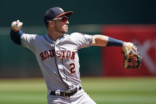 Aug 18, 2019; Oakland, CA, USA; Houston Astros third baseman Alex Bregman (2) throws the ball to first base to record an out during the first inning against the Oakland Athletics at Oakland Coliseum. Mandatory Credit: Darren Yamashita-USA TODAY Sports