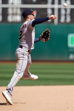 Aug 18, 2019; Oakland, CA, USA; Houston Astros third baseman Alex Bregman (2) throws the ball to first base to record an out during the eighth inning against the Oakland Athletics at Oakland Coliseum. Mandatory Credit: Darren Yamashita-USA TODAY Sports