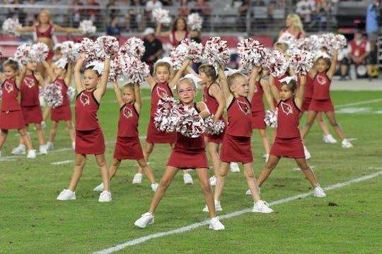 Aug 15, 2019; Glendale, AZ, USA; Arizona Cardinals junior cheerleaders dance during an NFL football game against the Oakland Raiders. The Raiders defeated the Cardinals 33-26. Mandatory Credit: Kirby Lee-USA TODAY Sports