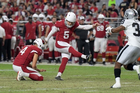Aug 15, 2019; Glendale, AZ, USA; Arizona Cardinals kicker Zane Gonzalez (5) kicks an extra point out of the hold of punter Andy Lee (4) during an NFL football game against the Oakland Raiders. The Raiders defeated the Cardinals 33-26. Mandatory Credit: Kirby Lee-USA TODAY Sports
