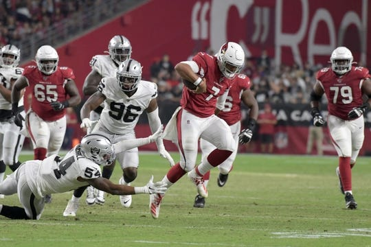 Aug 15, 2019; Glendale, AZ, USA; Arizona Cardinals quarterback Brett Hundley (7) is pursued by Oakland Raiders defensive end Clelin Ferrell (96) and linebacker Brandon Marshall (54) during an NFL football game. The Raiders defeated the Cardinals 33-26. Mandatory Credit: Kirby Lee-USA TODAY Sports