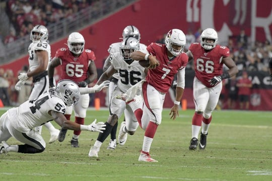 Aug 15, 2019; Glendale, AZ, USA; Arizona Cardinals quarterback Brett Hundley (7) is pursued by Oakland Raiders defensive end Clelin Ferrell (96) and inside linebacker Brandon Marshall (54) during an NFL football game. The Raiders defeated the Cardinals 33-26. Mandatory Credit: Kirby Lee-USA TODAY Sports
