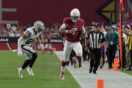 Aug 15, 2019; Glendale, AZ, USA; Arizona Cardinals quarterback Brett Hundley (7) is pursued by Oakland Raiders free safety Erik Harris (25) during an NFL football game. The Raiders defeated the Cardinals 33-26. Mandatory Credit: Kirby Lee-USA TODAY Sports