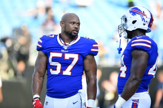 Aug 16, 2019; Charlotte, NC, USA; Buffalo Bills outside linebacker Lorenzo Alexander (57) on the field with linebacker Deon Lacey (44) before the game at Bank of America Stadium. Mandatory Credit: Bob Donnan-USA TODAY Sports