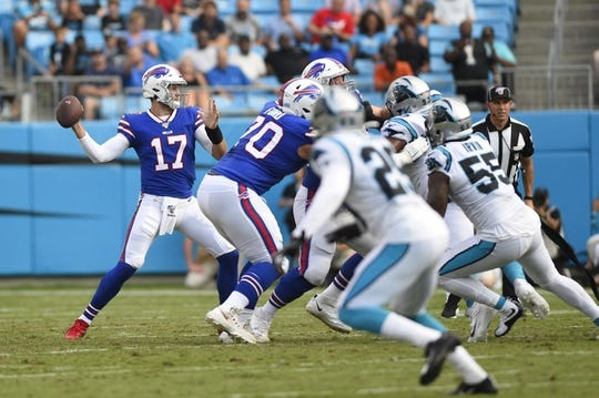 Aug 16, 2019; Charlotte, NC, USA; Buffalo Bills quarterback Josh Allen (17) looks to pass in the first half at Bank of America Stadium. Mandatory Credit: Bob Donnan-USA TODAY Sports