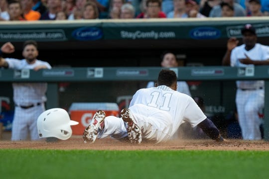 Aug 23, 2019; Minneapolis, MN, USA; Minnesota Twins shortstop Jorge Polanco (11) slides home in the first inning against Detroit Tigers during an MLB Players' Weekend game at Target Field. Mandatory Credit: Brad Rempel-USA TODAY Sports