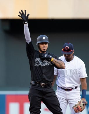 Aug 23, 2019; Minneapolis, MN, USA;  Detroit Tigers outfielder Harold Castro (30) doubles in the first inning against Minnesota Twins during an MLB Players' Weekend game at Target Field. Mandatory Credit: Brad Rempel-USA TODAY Sports