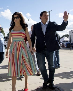 Aug 24, 2019; Orlando, FL, USA; Florida Governor Ron DeSantis and his wife Casey DeSantis arrive prior to the game between the Miami Hurricanes and the Florida Gators at Camping World Stadium. Mandatory Credit: Jasen Vinlove-USA TODAY Sports