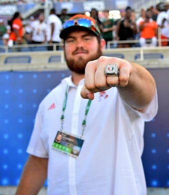 Aug 24, 2019; Orlando, FL, USA; Jacksonville Jaguars offensive tackle and former Miami Hurricanes player KC McDermott shows off his 2017 ACC Coastal Championship ring prior to the game between the Miami Hurricanes and the Florida Gators at Camping World Stadium. Mandatory Credit: Jasen Vinlove-USA TODAY Sports