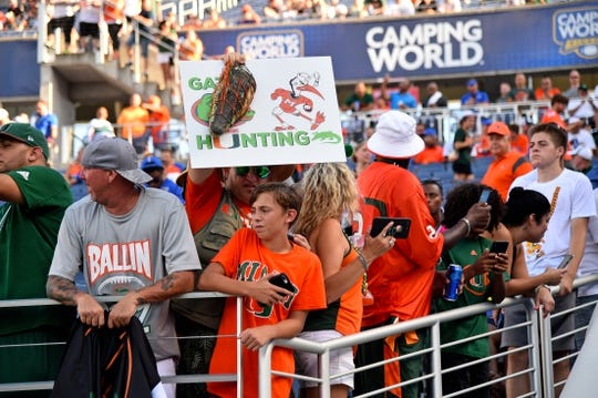 Aug 24, 2019; Orlando, FL, USA; Miami Hurricanes fans hold up signs prior to the game between the Miami Hurricanes and the Florida Gators at Camping World Stadium. Mandatory Credit: Jasen Vinlove-USA TODAY Sports
