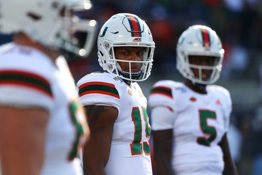 Aug 24, 2019; Orlando, FL, USA; Miami Hurricanes quarterback Jarren Williams (15) and quarterback N'Kosi Perry (5) works out before a game against the Florida Gators at Camping World Stadium. Mandatory Credit: Kim Klement-USA TODAY Sports