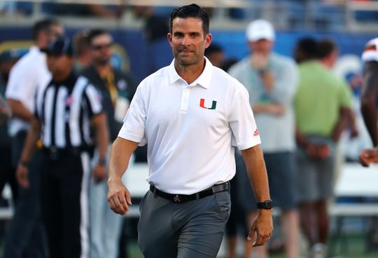 Aug 24, 2019; Orlando, FL, USA; Miami Hurricanes head coach Manny Diaz looks on before a game against the Florida Gators at Camping World Stadium. Mandatory Credit: Kim Klement-USA TODAY Sports
