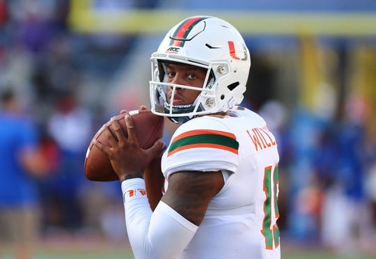 Aug 24, 2019; Orlando, FL, USA; Miami Hurricanes quarterback Jarren Williams (15) works out prior to a game against the Florida Gators at Camping World Stadium. Mandatory Credit: Kim Klement-USA TODAY Sports