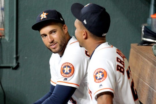 Aug 20, 2019; Houston, TX, USA; Houston Astros center fielder George Springer (4, left) talks with Houston Astros left fielder Michael Brantley (23) prior to the game against the Detroit Tigers at Minute Maid Park. Mandatory Credit: Erik Williams-USA TODAY Sports