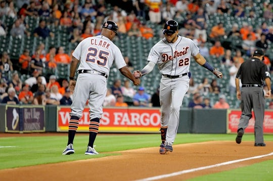 Aug 20, 2019; Houston, TX, USA; Detroit Tigers center fielder Victor Reyes (22, right) celebrates with Detroit Tigers third base coach Dave Clark (25) after hitting a home run against the Houston Astros at Minute Maid Park. Mandatory Credit: Erik Williams-USA TODAY Sports