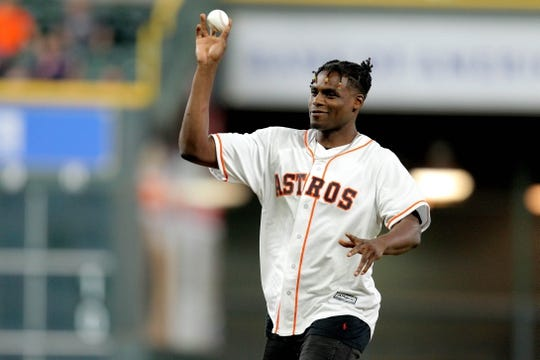 Aug 20, 2019; Houston, TX, USA; Houston Rockets forward Danuel House Jr. throws out the first pitch prior to the game between the Houston Astros and  the Detroit Tigers at Minute Maid Park. Mandatory Credit: Erik Williams-USA TODAY Sports