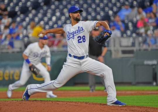 Aug 26, 2019; Kansas City, MO, USA; Kansas City Royals relief pitcher Jorge Lopez (28) delivers a pitch during the second inning against Oakland Athletics at Kauffman Stadium. Mandatory Credit: Peter G. Aiken