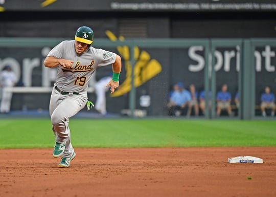 Aug 26, 2019; Kansas City, MO, USA; Oakland Athletics catcher Josh Phegley (19) rounds second base to score a run during the second inning against the Kansas City Royals at Kauffman Stadium. Mandatory Credit: Peter G. Aiken