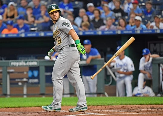 Aug 26, 2019; Kansas City, MO, USA; Oakland Athletics catcher Josh Phegley (19) walks with the bases loaded to drive in a run during the second inning against the Kansas City Royals at Kauffman Stadium. Mandatory Credit: Peter G. Aiken