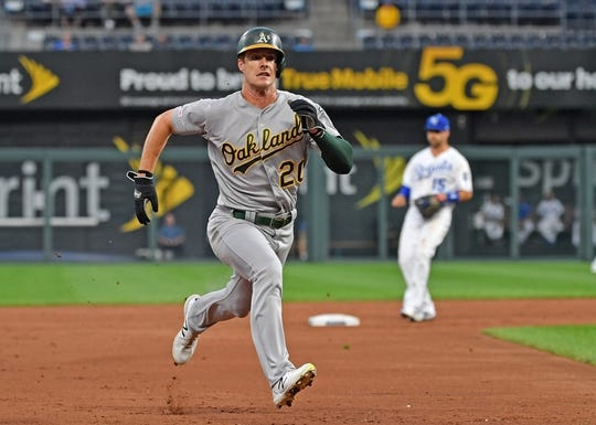 Aug 26, 2019; Kansas City, MO, USA; Oakland Athletics center fielder Mark Canha (20) runs to third base during the second inning against the Kansas City Royals at Kauffman Stadium. Mandatory Credit: Peter G. Aiken