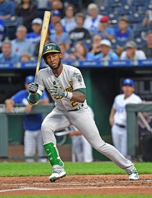 Aug 26, 2019; Kansas City, MO, USA; Oakland Athletics second baseman Jurickson Profar (23) walks with the bases loaded to drive in a run during the second inning against the Kansas City Royals at Kauffman Stadium. Mandatory Credit: Peter G. Aiken