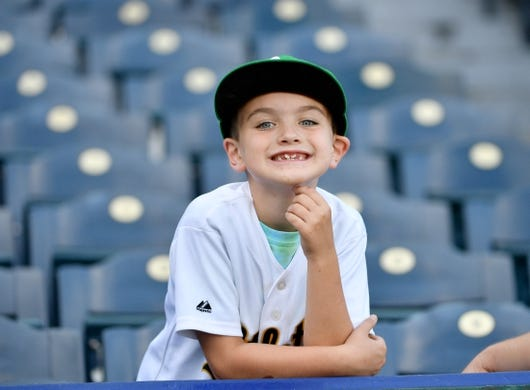 Aug 27, 2019; Kansas City, MO, USA; A young Oakland Athletics fan looks on from the stands during batting practice before the game against the Kansas City Royals at Kauffman Stadium. Mandatory Credit: Denny Medley-USA TODAY Sports