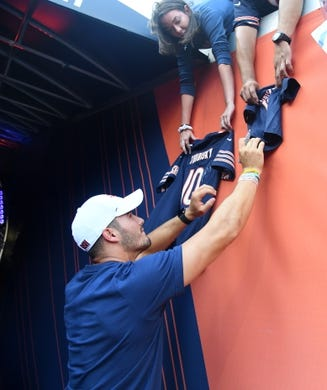 Aug 29, 2019; Chicago, IL, USA; Chicago Bears quarterback Mitchell Trubisky (10) sings autographs before the game against the Tennessee Titans at Soldier Field. Mandatory Credit: Mike DiNovo-USA TODAY Sports