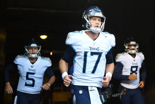 Aug 29, 2019; Chicago, IL, USA; Tennessee Titans quarterback Ryan Tannehill (17) takes the field before the game against the Chicago Bears at Soldier Field. Mandatory Credit: Mike DiNovo-USA TODAY Sports