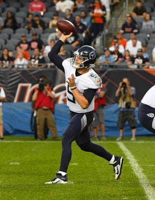 Aug 29, 2019; Chicago, IL, USA; Tennessee Titans quarterback Logan Woodside (5) drops back to pass against the Chicago Bears during the first half at Soldier Field. Mandatory Credit: Mike DiNovo-USA TODAY Sports