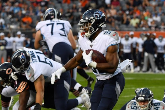 Aug 29, 2019; Chicago, IL, USA; Tennessee Titans running back Jeremy McNichols (30) rushes the ball against the Chicago Bears during the first half at Soldier Field. Mandatory Credit: Mike DiNovo-USA TODAY Sports
