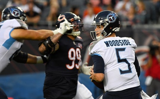 Aug 29, 2019; Chicago, IL, USA; Tennessee Titans quarterback Logan Woodside (5) drops back to pass against Chicago Bears outside linebacker Aaron Lynch (99) during the first half at Soldier Field. Mandatory Credit: Mike DiNovo-USA TODAY Sports