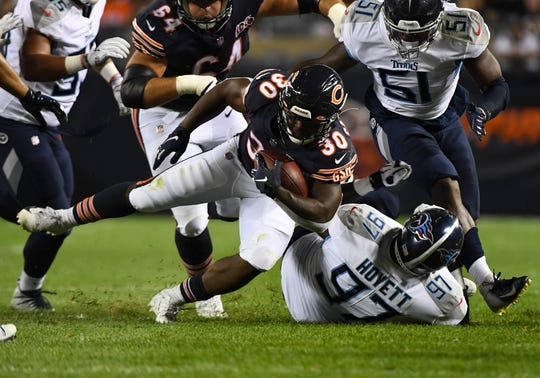 Aug 29, 2019; Chicago, IL, USA; Chicago Bears running back Josh Caldwell (30) rushes the ball against Tennessee Titans defensive tackle Braxton Hoyett (97) during the first half at Soldier Field. Mandatory Credit: Mike DiNovo-USA TODAY Sports