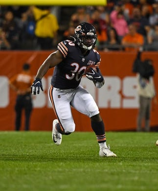 Aug 29, 2019; Chicago, IL, USA; Chicago Bears running back Josh Caldwell (30) rushes the ball against the Tennessee Titans during the first half at Soldier Field. Mandatory Credit: Mike DiNovo-USA TODAY Sports