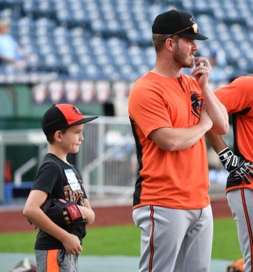 Aug 30, 2019; Kansas City, MO, USA; Baltimore Orioles starting pitcher Dylan Bundy (37) watches batting practice with his nephew Braxton Bundy before the game against the Kansas City Royals at Kauffman Stadium. Mandatory Credit: Denny Medley-USA TODAY Sports