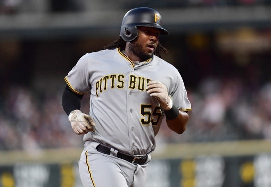 Aug 31, 2019; Denver, CO, USA; Pittsburgh Pirates first baseman Josh Bell (55) runs out his solo home run in the fourth inning against the Colorado Rockies at Coors Field. Mandatory Credit: Ron Chenoy-USA TODAY Sports
