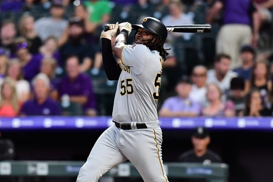 Aug 31, 2019; Denver, CO, USA; Pittsburgh Pirates first baseman Josh Bell (55) hits a solo home run in the fourth inning against the Pittsburgh Pirates at Coors Field. Mandatory Credit: Ron Chenoy-USA TODAY Sports