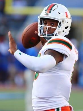 Aug 24, 2019; Orlando, FL, USA; Miami Hurricanes quarterback Jarren Williams (15) works out prior to the game against the Florida Gators at Camping World Stadium. Mandatory Credit: Kim Klement-USA TODAY Sports
