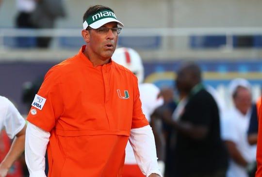 Aug 24, 2019; Orlando, FL, USA; Miami Hurricanes offensive coordinator Dan Enos prior to the game at Camping World Stadium. Mandatory Credit: Kim Klement-USA TODAY Sports
