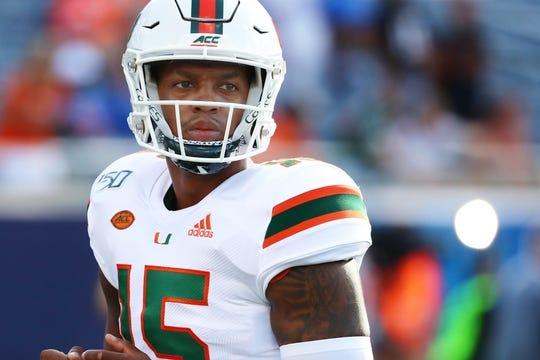 Aug 24, 2019; Orlando, FL, USA; Miami Hurricanes quarterback Jarren Williams (15) works out prior to the game at Camping World Stadium. Mandatory Credit: Kim Klement-USA TODAY Sports