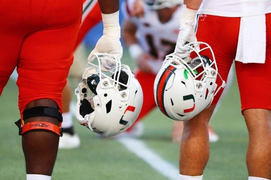 Aug 24, 2019; Orlando, FL, USA;A deal view of Miami Hurricanes helmets prior to the game at Camping World Stadium. Mandatory Credit: Kim Klement-USA TODAY Sports