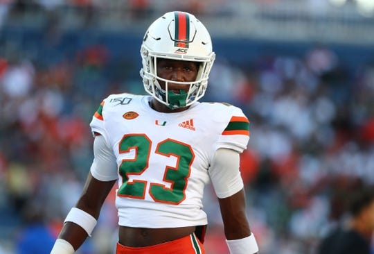 Aug 24, 2019; Orlando, FL, USA; Miami Hurricanes cornerback Te'Cory Couch (23) works out prior to the game at Camping World Stadium. Mandatory Credit: Kim Klement-USA TODAY Sports