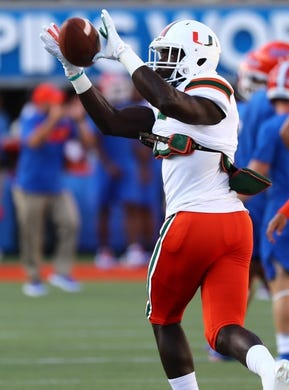 Aug 24, 2019; Orlando, FL, USA; Miami Hurricanes safety Amari Carter (5) works out prior to the game at Camping World Stadium. Mandatory Credit: Kim Klement-USA TODAY Sports