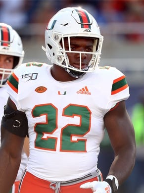 Aug 24, 2019; Orlando, FL, USA; Miami Hurricanes running back Robert Burns (22) works out prior to the game at Camping World Stadium. Mandatory Credit: Kim Klement-USA TODAY Sports